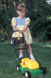 Little Girl with toy lawn mower.