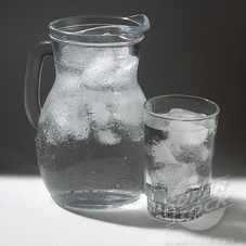 Glass and jug of ice water